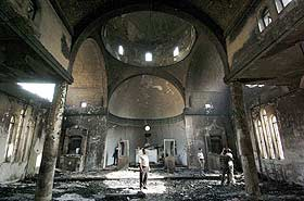 Iglesia cristiana dañada por una explosión en Bagdad (AFP)
